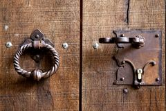 Two metal handles in the form of a ring on the old wooden door. royalty free stock photography