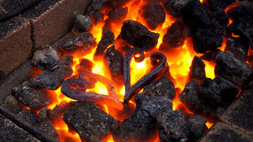Two metal hearts. In the hot fire Royalty Free Stock Photos