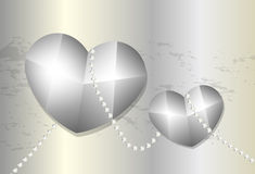 Two metal hearts tied up with chain on metal background Stock Photos