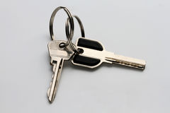 two metal keys on a homogeneous gray background Stock Image