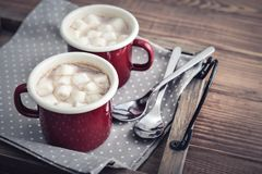 Two metal mugs cocoa with marshmallows Royalty Free Stock Photography