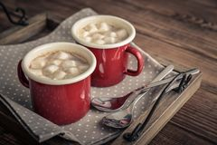 Two metal mugs cocoa with marshmallows Royalty Free Stock Photo