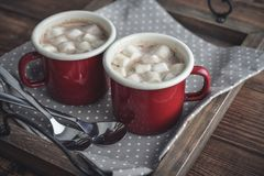 Two metal mugs cocoa with marshmallows Royalty Free Stock Images