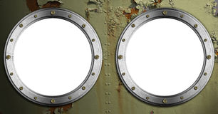 Two Metal Portholes on Green Background Royalty Free Stock Photography
