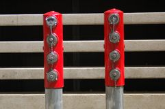 Two Posts w/ 8 Fire Hose Plugs in Portland, Oregon. These are two metal posts in front of a concrete building that each have four fire hose plugs Royalty Free Stock Images