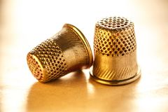 Two metal sewing thimbles Stock Photo