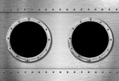 Two metal ship portholes Stock Photography