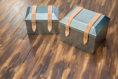 Two metal tool box on wooden table. Studio Shot stock photography