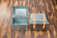Two metal tool box on wooden table. Studio Shot royalty free stock photo