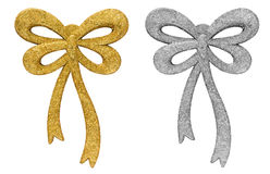 Two metallic glitter bow decorations Royalty Free Stock Photo