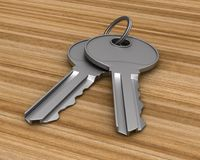 Two metallic keys on wooden surface. 3d illustration.  Royalty Free Stock Photos