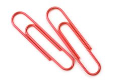 Two metallic red paper clips isolated on white Royalty Free Stock Photos