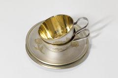 Two metallic saucer and coffee cup in stack Royalty Free Stock Photos