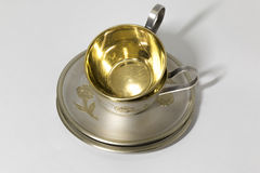 Two metallic saucer and coffee cup in stack Royalty Free Stock Photography