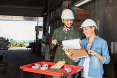 Two metalworkers with checklist Stock Images