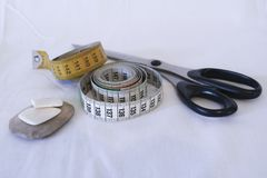 Two meters of tailoring, scissors and chalk, sewing objects royalty free stock photo
