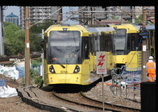 Two Metrolink trams arriving, Manchester Victoria Stock Photos