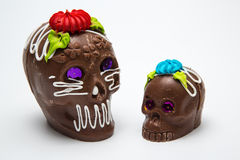 Two Mexican Calaverita de azucar Candy Skull and Calaverita de Chocolate, Royalty Free Stock Images