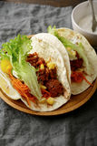 Two Mexican Tacos on a wooden plate Stock Image
