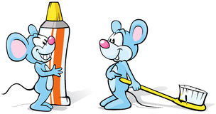 Two mice with toothpaste and toothbrush Stock Images