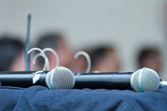 Two microphones. In stand-by position lying on a table Stock Photography