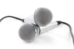 Two microphones. Style, speech, white, media Royalty Free Stock Image
