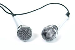 Two microphones. Two microphones with a black cord Royalty Free Stock Photos