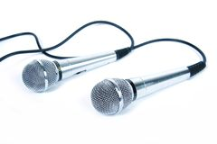 Two microphones. Two microphones with a black cord Stock Photo