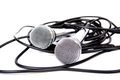 Two microphones. Two microphones with a black cord Stock Photos