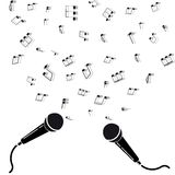 Two microphones black silhouette with notes. Stock Photography