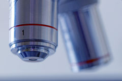 Two microscope lenses, blue tint Royalty Free Stock Photo