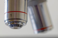 Two microscope lenses Stock Images