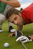 Two mid adult men playing golf Stock Images