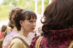 Two middle-aged ladies wearing historical costumes at a ball stock photo