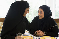 Two Middle Eastern women enjoying a meal royalty free stock photo
