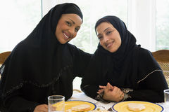 Two Middle Eastern women enjoying a meal stock photo
