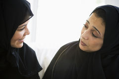 Two Middle Eastern women talking together Stock Image