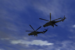 Two military helicopters flying combat Stock Photography