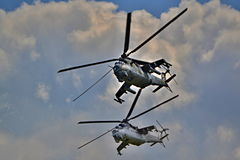 Two military helicopters flying together - army and military technology demonstrations Royalty Free Stock Image