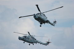 Two Military Helicopters. A photo close up of a Military helicopters used by the British Royal Navy on a mild english afternoon. Made possible by yeovilton Stock Photography