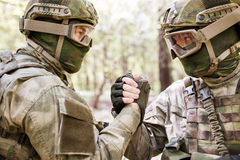 Two military men shaking hands Stock Images