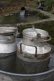 Two milk-churns in the tub. On the the courtyard Royalty Free Stock Image