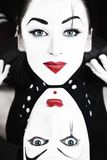 Two mimes with blue eyes Royalty Free Stock Images