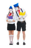 Two mimes with books Royalty Free Stock Photos