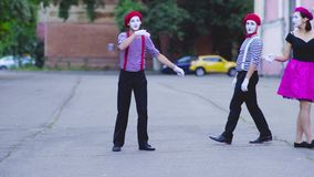 Two mimes girls show. Acting on the street. Performance of street artist stock video