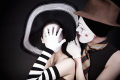 Two mimes in hats stock images