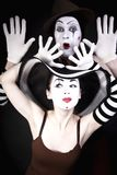 Two mimes in hats on black background Royalty Free Stock Photo