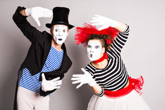 Two mimes man and  woman. April Fool's Day concept. Two mimes men and  woman. April Fool's Day concept Royalty Free Stock Image