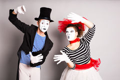 Two mimes man and woman, April Fools Day concept. Two mimes men and woman, April Fools Day concept royalty free stock photos
