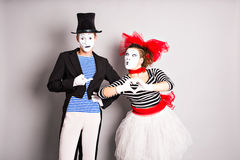 Two mimes man and woman.The concept of Valentine's Day, April Fool's Day. Two mimes men and woman.The concept of Valentine's Day, April Fool's Day stock images